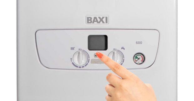 Hand Pushing Baxi Boiler Buttons