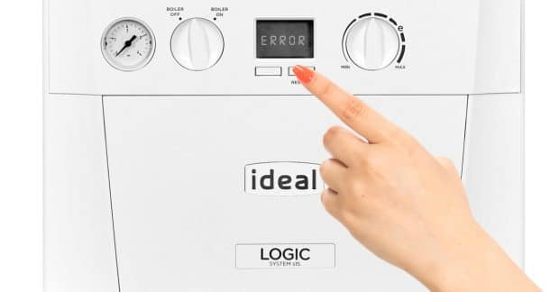 Hand Pushing Ideal Boiler Buttons