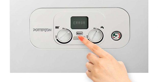 Hand Pushing Potterton Boiler Buttons