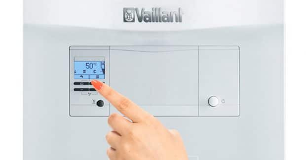 Hand Pushing Vaillant Boiler Buttons