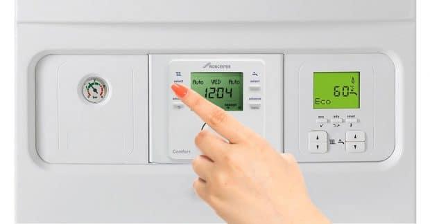 Hand Pushing Worcester Bosch Boiler Buttons