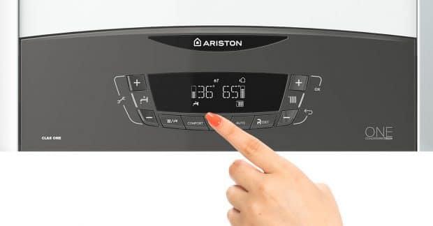 Hand Pushing Ariston Boiler Buttons