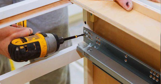 Handyman Assembling Cabinets