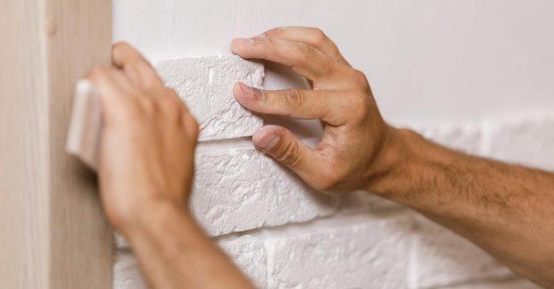 Man Tiling Wall