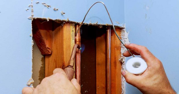 Plumber Soldering a Leaking Copper Pipe