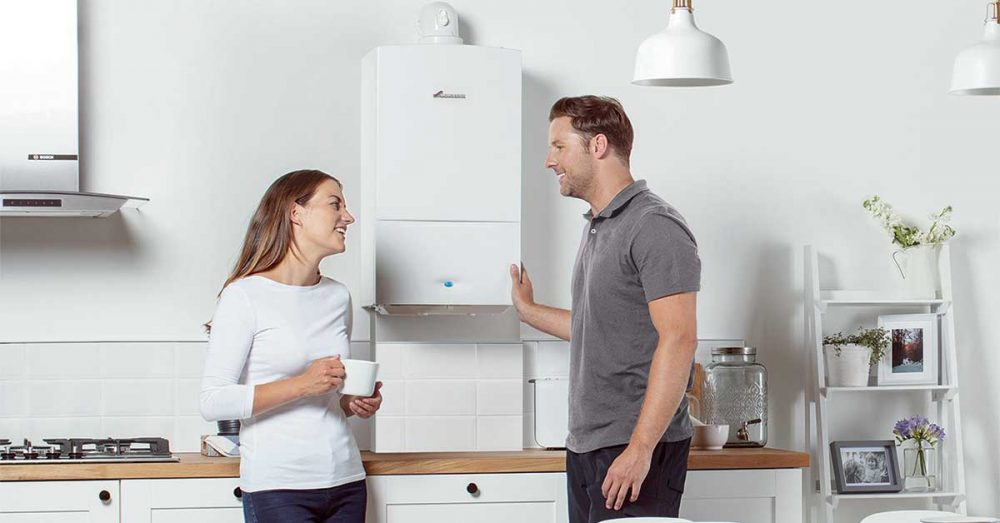 Combi Boiler Engineer Explaining to Customer